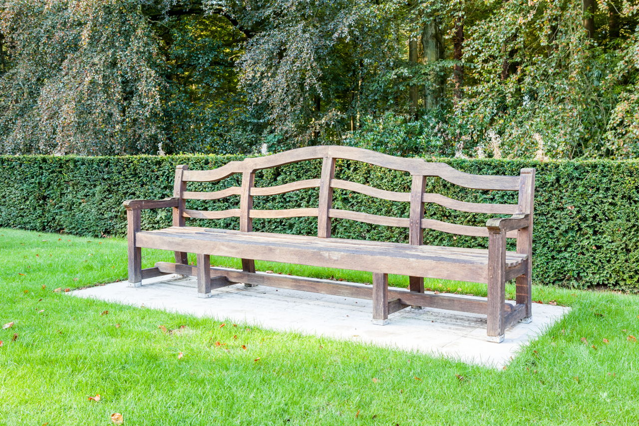 Long wooden bench as a garden bench for small plants