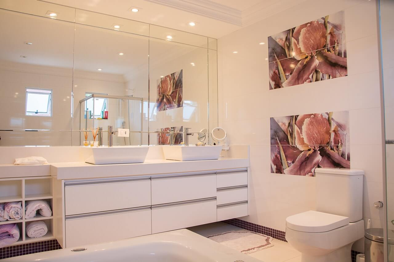 Organized bathroom with wall cabinets: